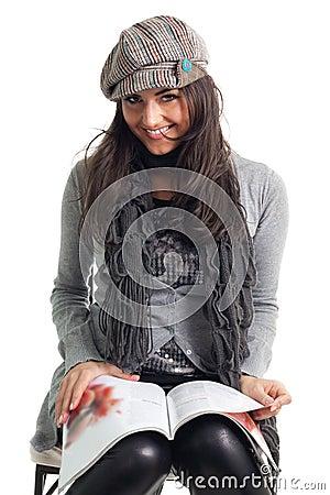 Stylish young woman read magazine