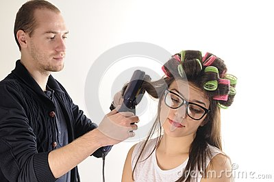 Stylist man working with model hair