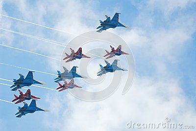 SU-27 and MIG-29 fighters performing aerobatics