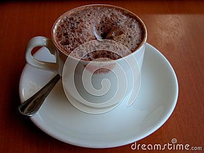 Sua chávena de café