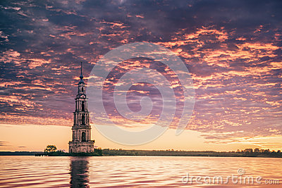 Submerged bell tower in river beautiful sunrise
