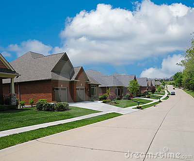 Suburban Street Lined With Brick Homes