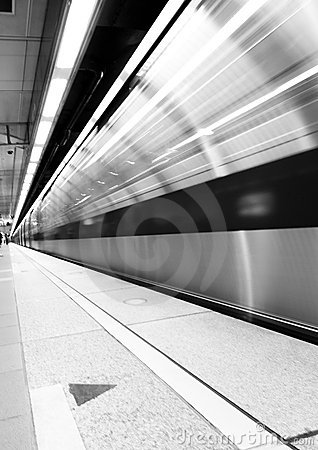 Subway in motion in the station