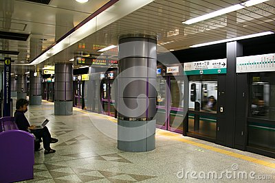 Subway train arriving at Tokyo Metro station Editorial Stock Image