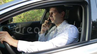 Succesful bussinessman talking on phone in car stock video footage