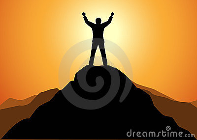 Success businessman standing on top of a mountain