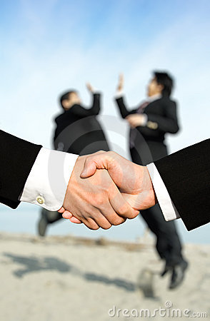 Success businessmen shaking hands