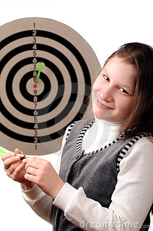 Success. Girl hitting the darts target