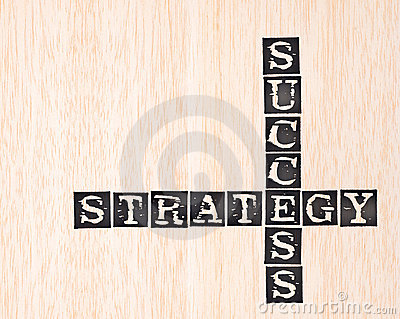 Success and strategy word stamped on wooden