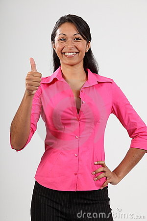 Success thumbs up from beautiful young woman