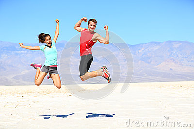 Success - young runners jumping