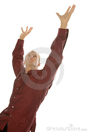 Successful business man reaching up with his arms