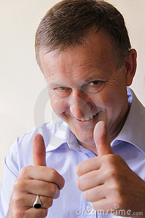 Successful business man with thumbs up