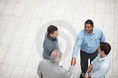 Successful business partners handshaking