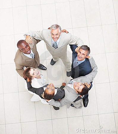 Successful business people forming a huddle