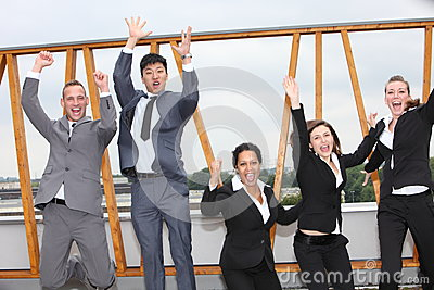 Successful business team cheering and rejoicing