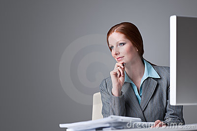 Successful business woman at office thinking