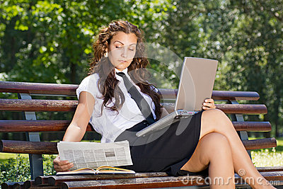 Successful business woman in park outdoor