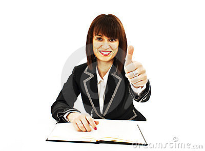 Successful business woman showing thumbs up sign