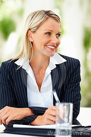 Successful business woman smiling at a meeting