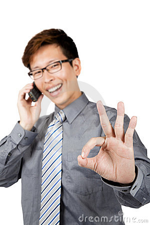 Successful businessman  calling on phone