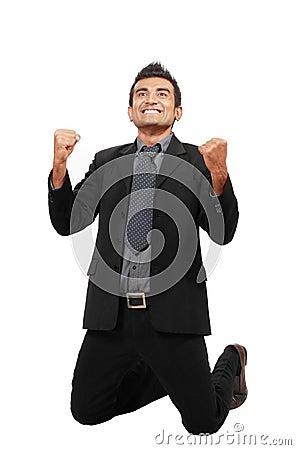 Successful businessman celebrating a win.
