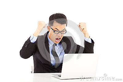 Successful businessman excited to raise his hands