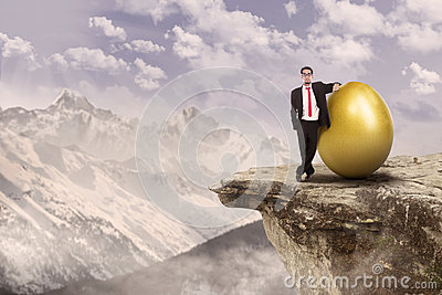 Successful businessman and gold egg