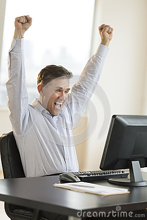 Successful Businessman Screaming While Using Computer