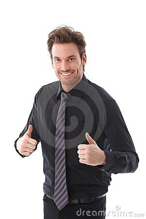 Successful businessman smiling thumbs up