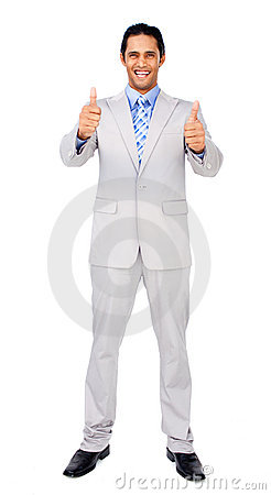 Successful businessman standing with thumbs up