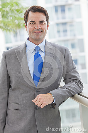 Successful Businessman In Suit on Rooftop