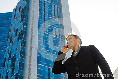 Successful businessman talking on mobile phone