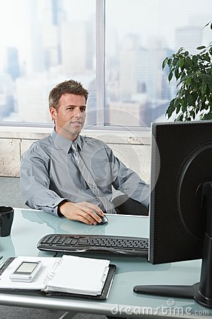 Successful businessman working at desk
