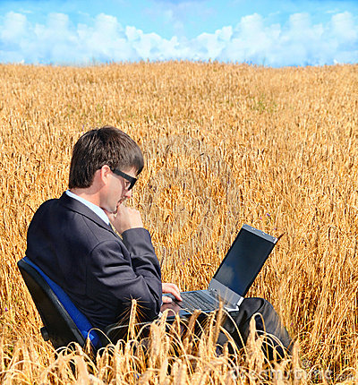 Successful businessman works in field