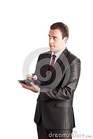 Successful businessman writing in clipboard