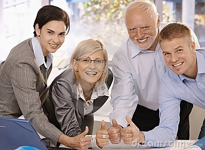 Successful businessteam giving thumbs up