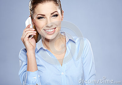 Successful businesswoman with cell phone.