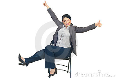 Successful businesswoman on chair gives thumbs