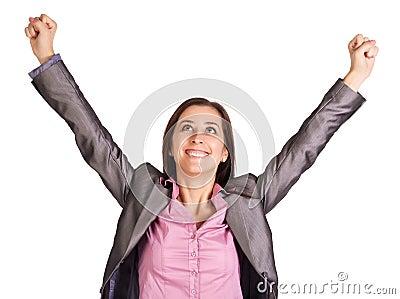 Successful businesswoman is raising her hands up