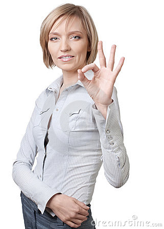 Successful businesswoman showing ok sign