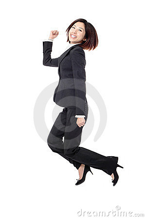 Successful businesswoman in suit jumping joyful