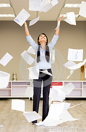 Successful businesswoman throwing papers