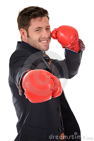 Successful caucasian businessman, boxing gloves