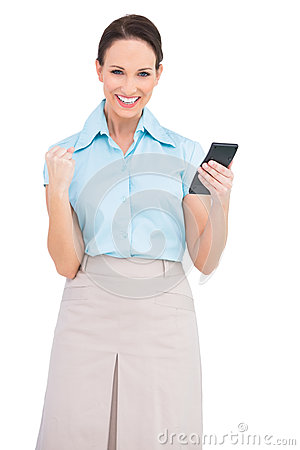 Free Successful Classy Businesswoman Using Calculator Royalty Free Stock Photo - 33030475