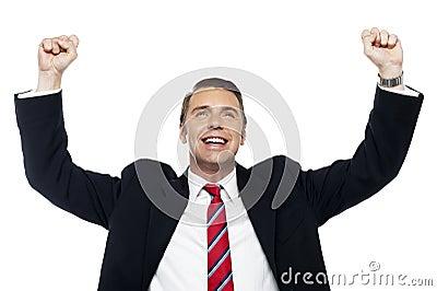 Successful corporate male, arms raised