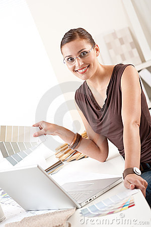 Successful designer woman at office with laptop