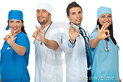 Successful doctors team showing okay sign