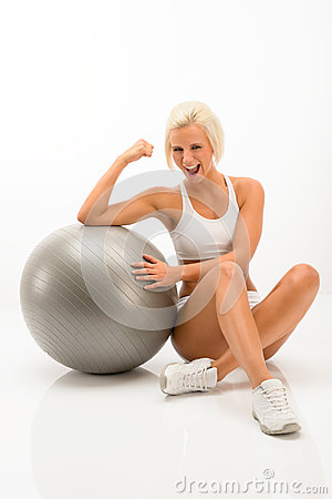 Successful fitness woman with exercise ball white