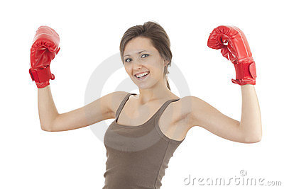Successful girl in boxing gloves